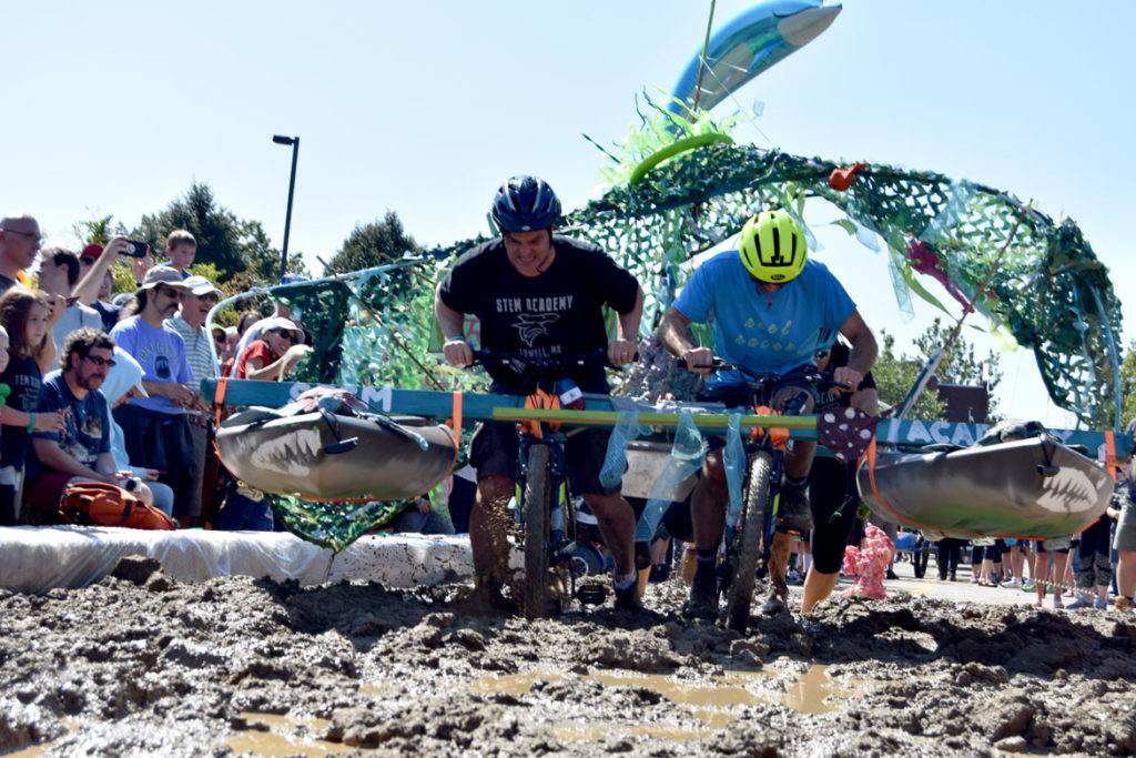 "The Lowell Kinetic Sculpture Race enters the ""Maddening Mud Pit,"" Sept. 21, 2019. (Greg Cook photo)"