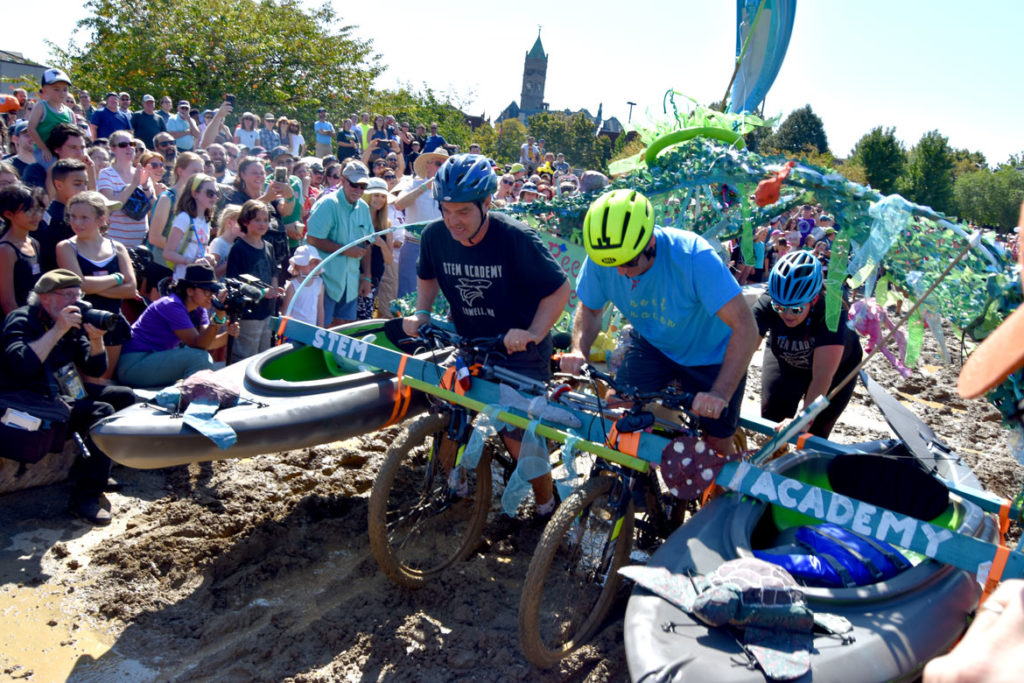 "Crossing the ""Maddening Mud Pit"" at the Lowell Kinetic Sculpture Race, Sept. 21, 2019. (Greg Cook photo)"
