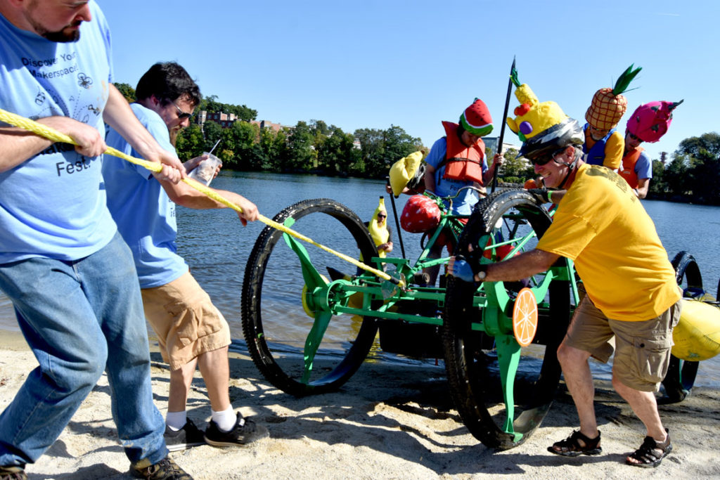 Getting pulled out of the Merrimack River during the Lowell Kinetic Sculpture Race, Sept. 21, 2019. (Greg Cook photo)