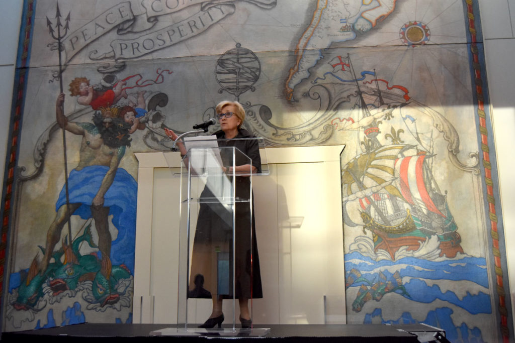 Peabody Essex Museum Chief Curator Lynda Roscoe Hartigan speaks in front of an N.C. Wyeth mural in the museum's new wing, Salem, Sept. 25, 2019. (Greg Cook photo)