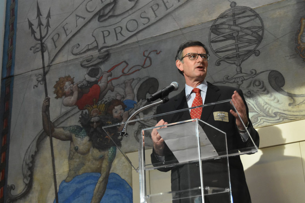 Peabody Essex Museum Director Brian Kennedy speaks in front of an N.C. Wyeth mural to announce the debut of the Salem museum's new wing, Sept. 25, 2019. (Greg Cook photo)