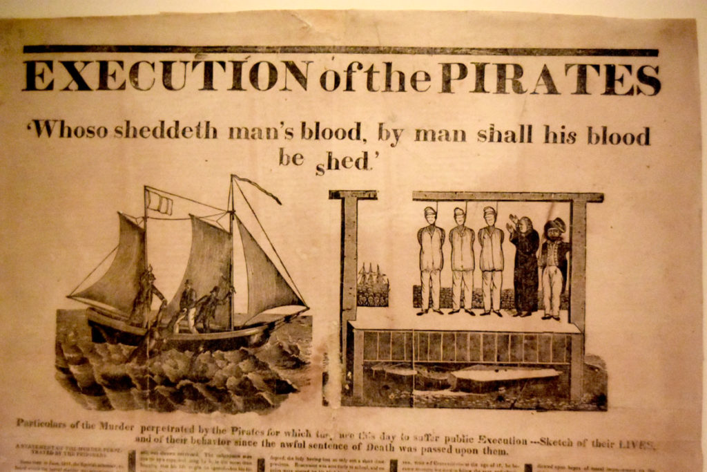 """""""Execution of Pirates"""" broadside from 1818 in the maritime galleries of the Peabody Essex Museum's new wing, Salem, Sept. 25, 2019. (Greg Cook photo)"""