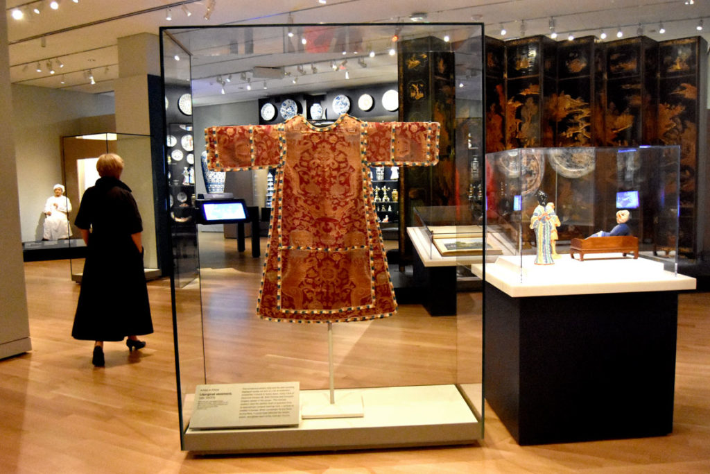 Brocaded silk priest's robe assembled in Spain from imported Chinese silk during the late 1600s. liturgical vestment. In the Asian Export Art Galleries in the Peabody Essex Museum's new wing, Salem, Sept. 25, 2019. (Greg Cook photo)