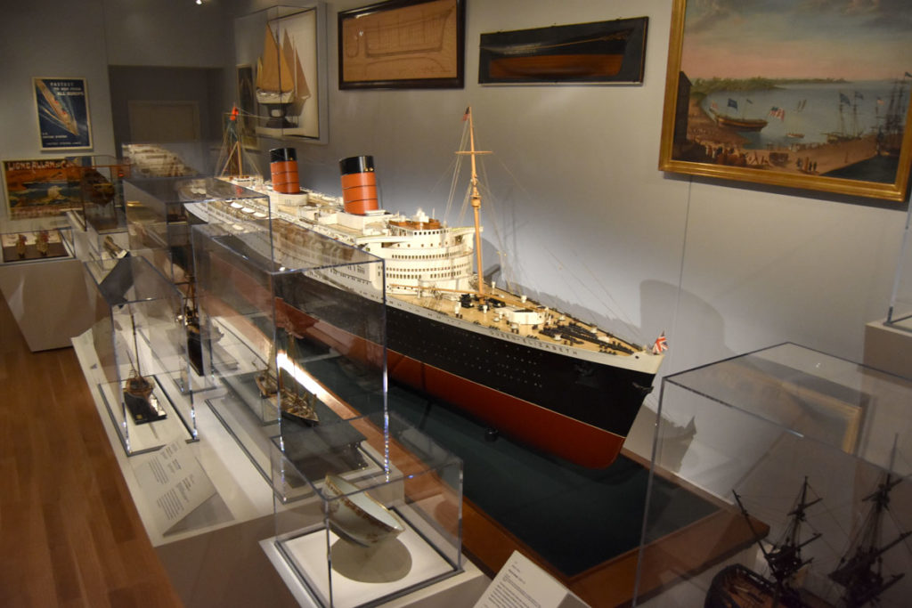 A white mahogany, gunmetal and brass model of RMS Queen Elizabeth by Bassett-Lowke LTD, 1947– 1948. In the maritime galleries in the Peabody Essex Museum's new wing, Salem, Sept. 25, 2019. (Greg Cook photo)