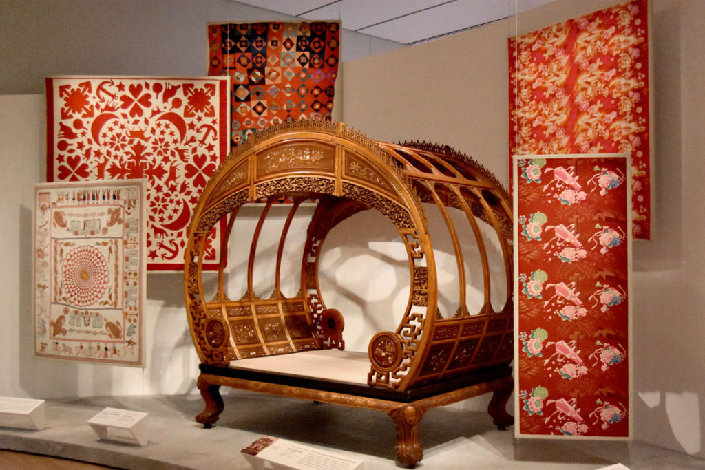 Moon-gate bed made in Ningbo, China, from wood and ivory around 1876. In the fashion and design galleries in the Peabody Essex Museum's new wing, Salem, Sept. 25, 2019. (Greg Cook photo)