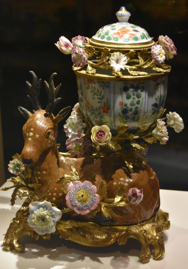 """Porcelain and gilded bronze """"Potpourri vase"""" by French, Chinese and Japanese artists depicting stag and flowers from about 1750. In the Asian Export Art galleries in Peabody Essex Museum's new wing, Salem, Sept. 25, 2019. (Greg Cook photo)"""