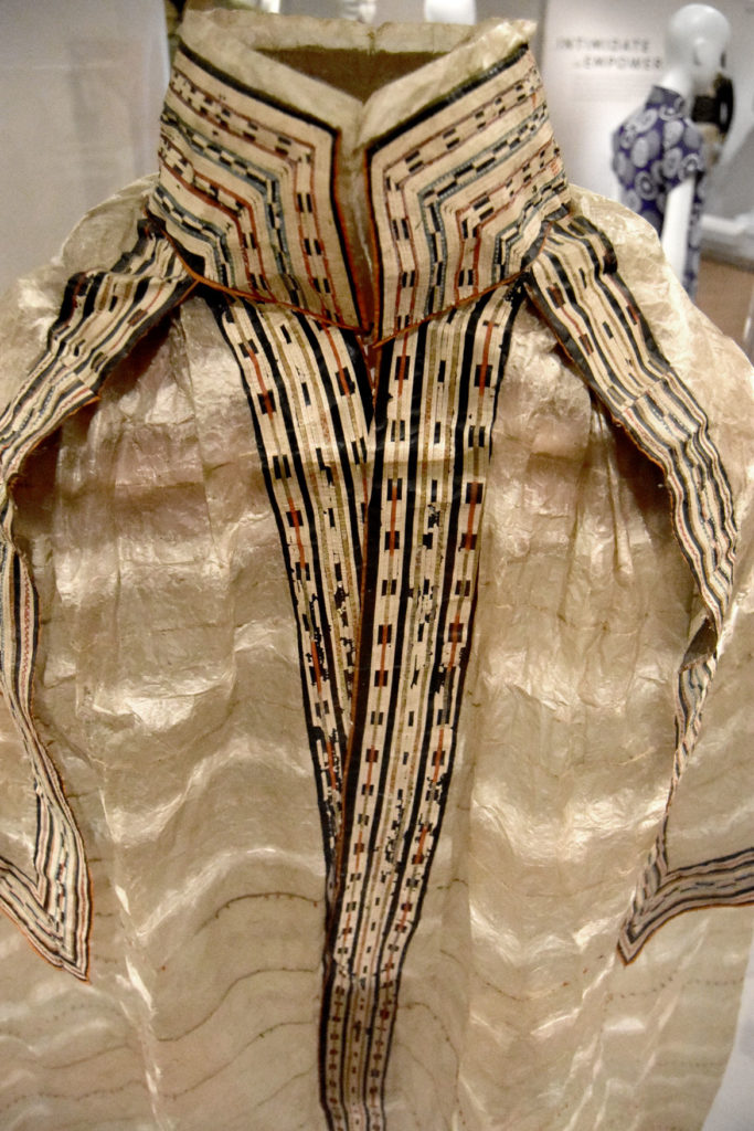 """""""Gut"""" cape stitched together from intestine, skin, dye by an Unangax (Aleut) artist between 1824 and 1827. In the fashion galleries in Peabody Essex Museum's new wing, Salem, Sept. 25, 2019. (Greg Cook photo)"""