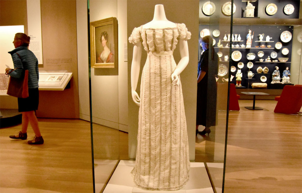 Waistcoat from the 1740s assembled in Sarah Ellen Derby Rogers's muslin and silver wedding reception dress from 1827, assembled in the United States from materials made in India. In the Asian Export Art galleries of the Peabody Essex Museum's new wing, Salem, Sept. 25, 2019. (Greg Cook photo)
