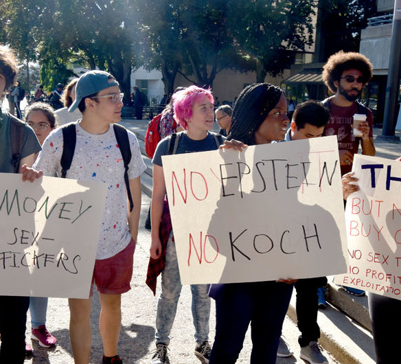 """MIT Rally Against Jeffrey Epstein"" and ""They Knew: Speak-out against MIT-Epstein Scandal"" outside Massachusetts Institute of Technology's Stratton Student Center, Sept. 13, 2019. (Greg Cook)"