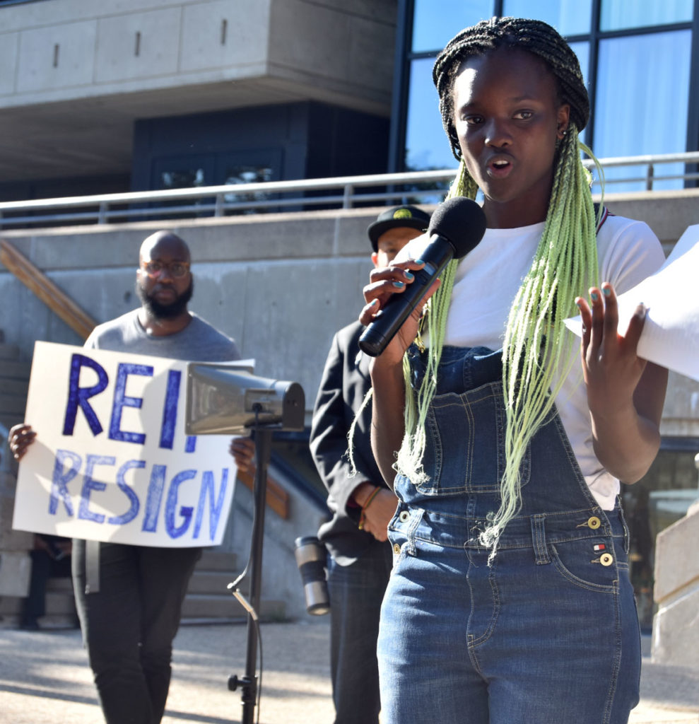 "MIT Media Lab student Arwa Mboya speaks at the ""MIT Rally Against Jeffrey Epstein"" and ""They Knew: Speak-out against MIT-Epstein Scandal"" outside Massachusetts Institute of Technology's Stratton Student Center, Sept. 13, 2019. (Greg Cook)"