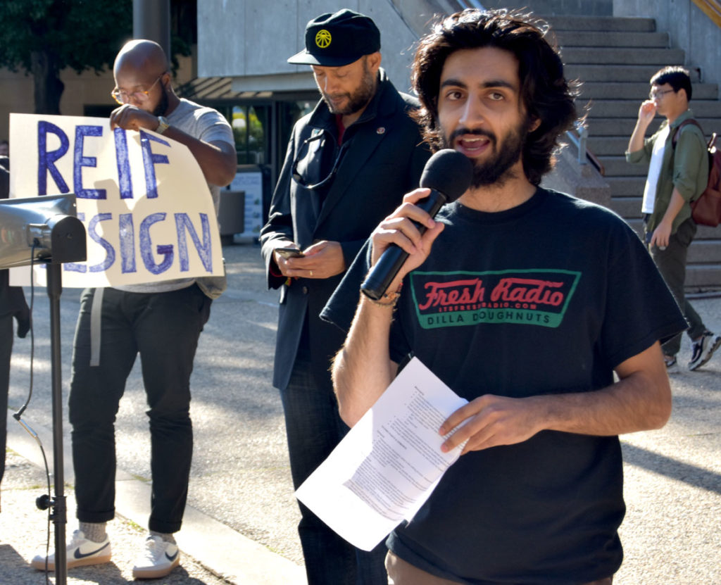 "Husayn Karimi of MIT Students Against War speaks at the ""MIT Rally Against Jeffrey Epstein"" and ""They Knew: Speak-out against MIT-Epstein Scandal"" outside Massachusetts Institute of Technology's Stratton Student Center, Sept. 13, 2019. (Greg Cook)"
