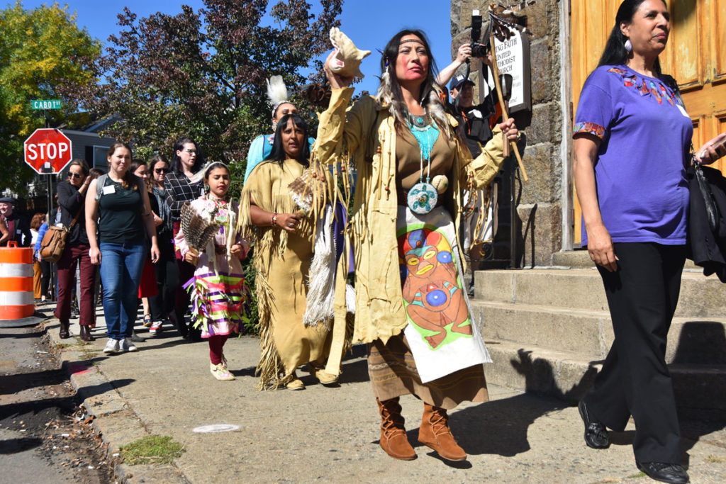 Massachusetts Center for Native American Awareness Intertribal Dancers from Danvers lead the crowd at the Essex County Community Foundation's second annual Essex County Arts & Culture Summit from the Cabot theater to Dane Street Church, Beverly, Sept. 27, 2019. (Greg Cook photo)