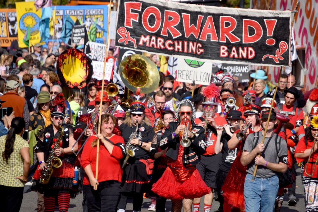 Forward! Marching Band from Madison, Wisconsin, reaches Harvard Square, Cambridge, during the Honk Parade, Oct. 13, 2019. (Greg Cook photo)