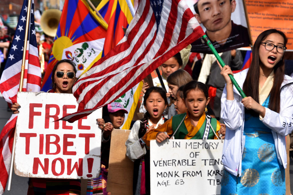 """Free Tibet Now!"" activists in the Honk Parade, Oct. 13, 2019. (Greg Cook photo)"