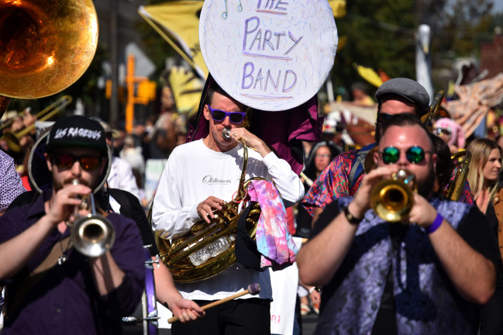 The Party Band from Lowell, Massachusetts, marches in the Honk Parade, Oct. 13, 2019. (Greg Cook photo)