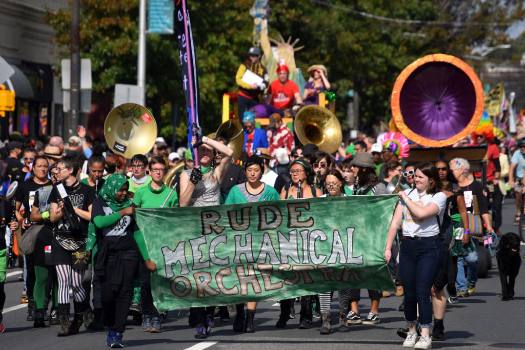Rude Mechanical Orchestra from New York marches in the Honk Parade, Oct. 13, 2019. (Greg Cook photo)