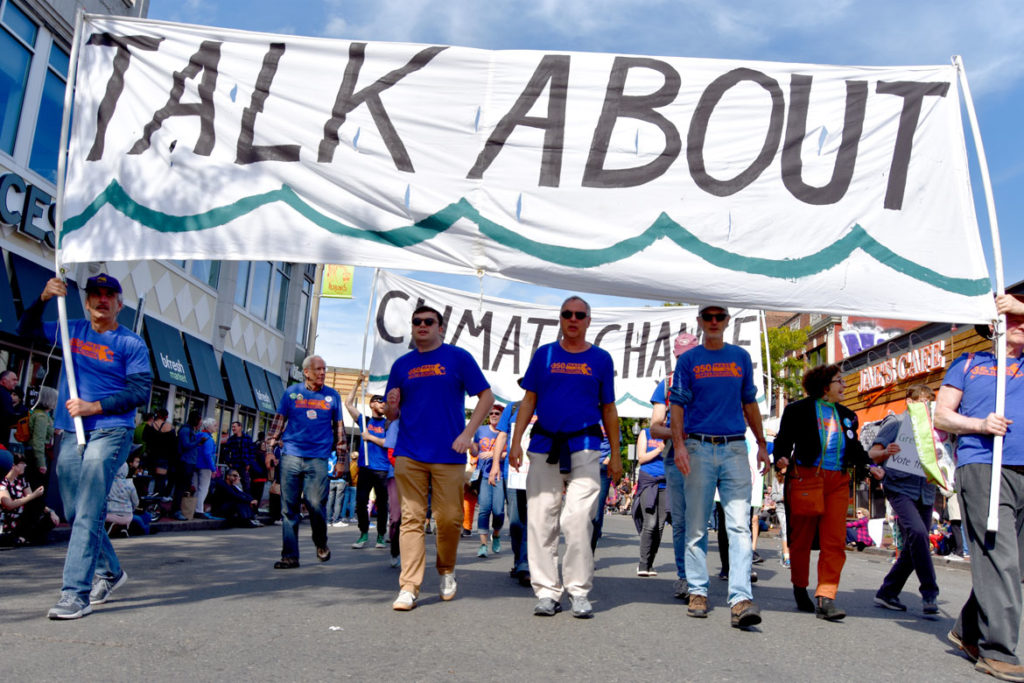 "350 Mass urges people to ""Talk About / Climate Change"" in the Honk Parade, Oct. 13, 2019. (Greg Cook photo)"