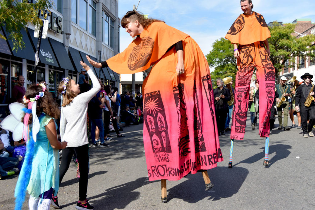 Bread and Puppet Theater stilters in the Honk Parade, Oct. 13, 2019. (Greg Cook photo)
