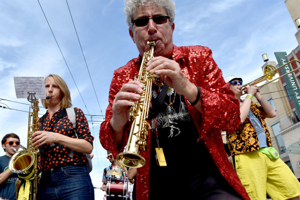 Ken Field performs in a pick-up band in the Honk Parade, Oct. 13, 2019. (Greg Cook photo)