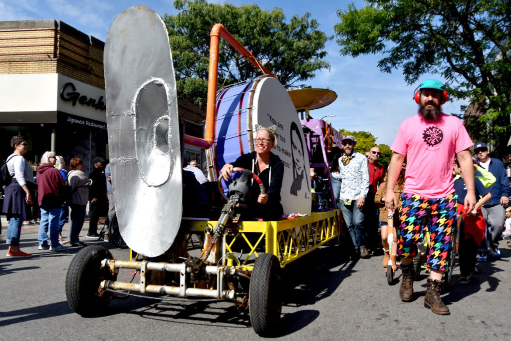 Parts and Crafts' contraption rolls out of Somerville's Davis Square during the Honk Parade, Oct. 13, 2019. (Greg Cook photo)