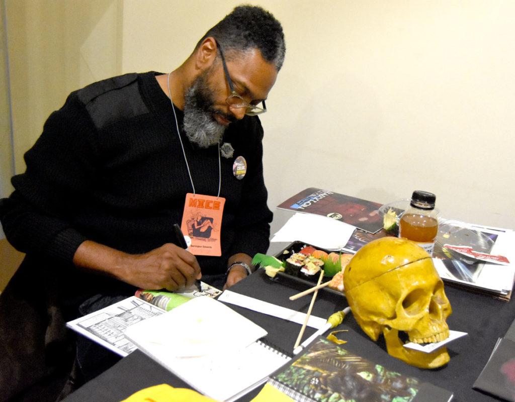 Boston-area artist Barrington Edwards at MICE (Massachusetts Independent Comics Expo) at Lesley University, Oct. 19, 2019. (Greg Cook photo)