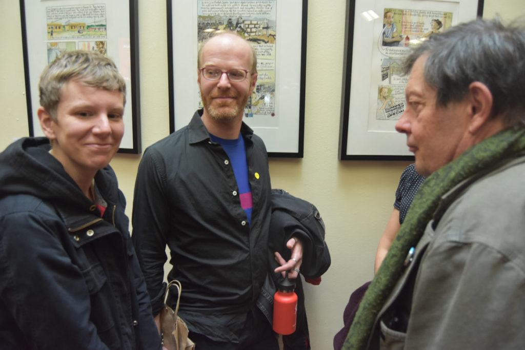 Tim Finn (center), owner of Somerville's Hub Comics, at MICE (Massachusetts Independent Comics Expo) at Lesley University, Oct. 19, 2019. (Greg Cook photo)