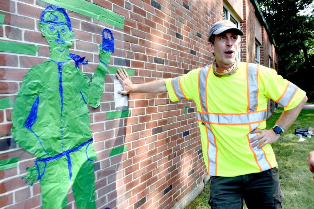 """Michael Townsend at the """"Pageant Picnic Day"""" from """"Drawing From Our Past: A Tri-Town Tape Art Festival"""" at Pentucket Regional Middle School in West Newbury, July 27, 2019. (Greg Cook photo)"""
