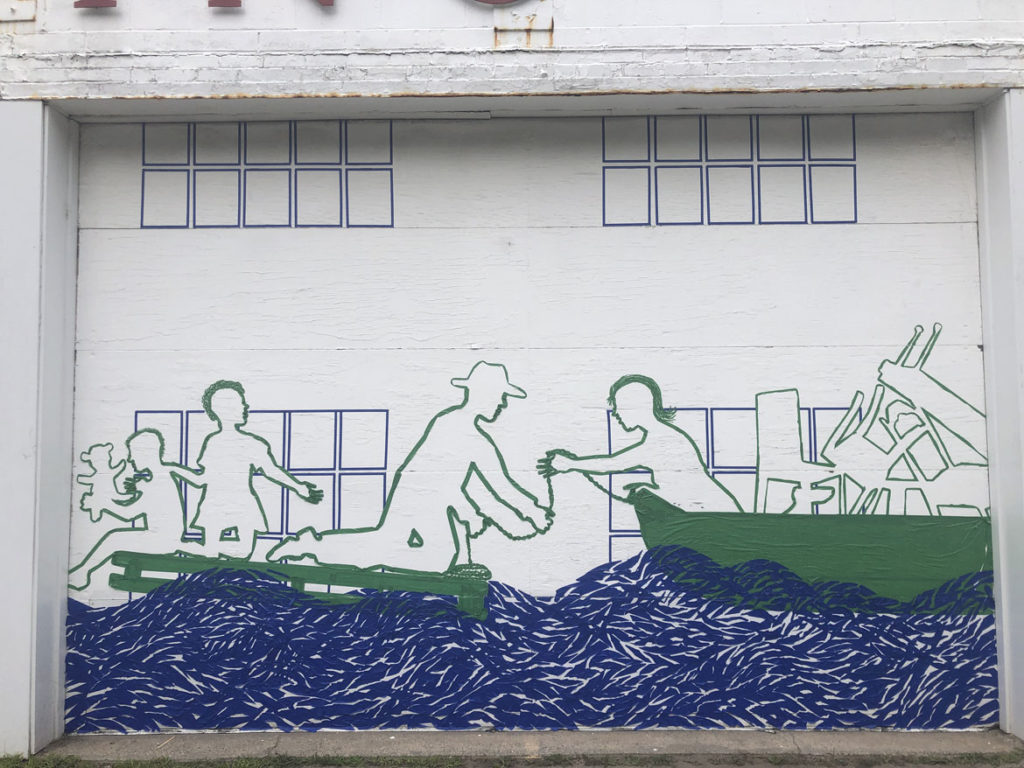 """Remembering a 1936 flood with a Tape Art mural across the doors of Kenoza Vending on Route 110 in Merrimac, July 2019. From """"Drawing From Our Past: A Tri-Town Tape Art Festival."""" (Tape Art photo)"""