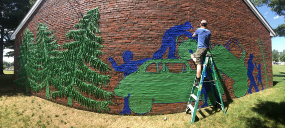 "Remembering the Pines Speedway with a Tape Art mural at Groveland's Langley-Adams Public Library, July 2019. From ""Drawing From Our Past: A Tri-Town Tape Art Festival."" (Tape Art photo)"