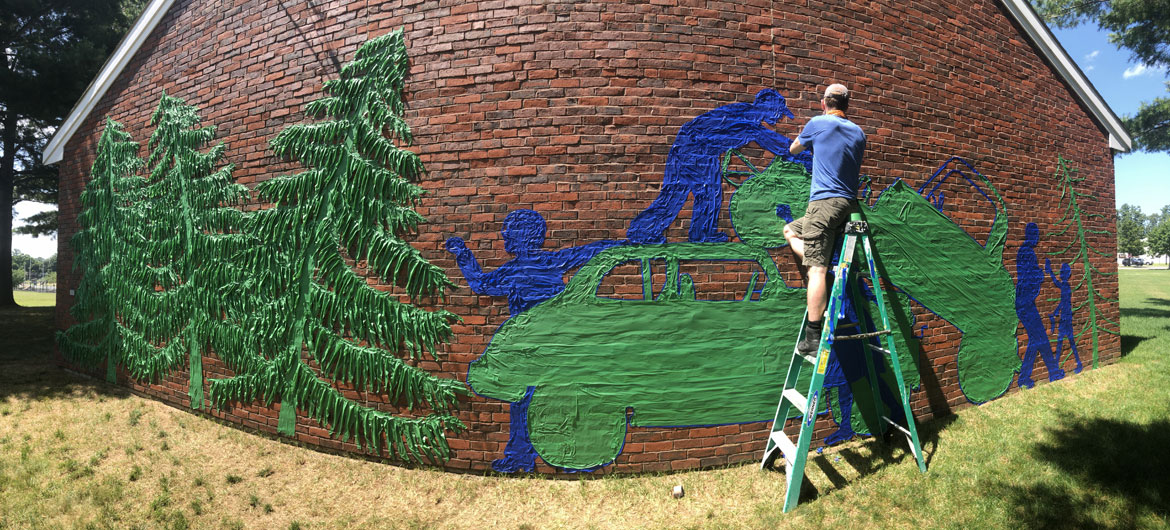 """Remembering the Pines Speedway with a Tape Art mural at Groveland's Langley-Adams Public Library, July 2019. From """"Drawing From Our Past: A Tri-Town Tape Art Festival."""" (Tape Art photo)"""