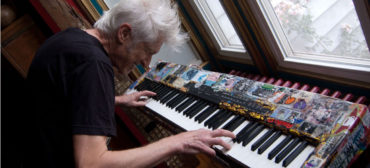 Willie Alexander plays his keyboard in his Gloucester home, July 15, 2017. (Greg Cook photo)