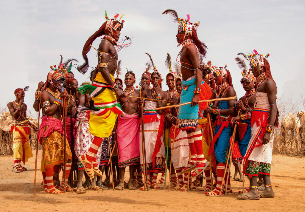 "The Rendille of northern Kenya's Kaisut Desert: ""Throughout the [Herr Heroon, or bull] ceremony, warriors gather in small groups to perform leaping dances, expressing their unity as a generation. When two warriors leap together the dance is called woyee,"" Carol Beckwith and Angela Fisher write in ""African Twilight: The Vanishing Rituals and Ceremonies of the African Continent,"" 2018. (Rizzoli)"