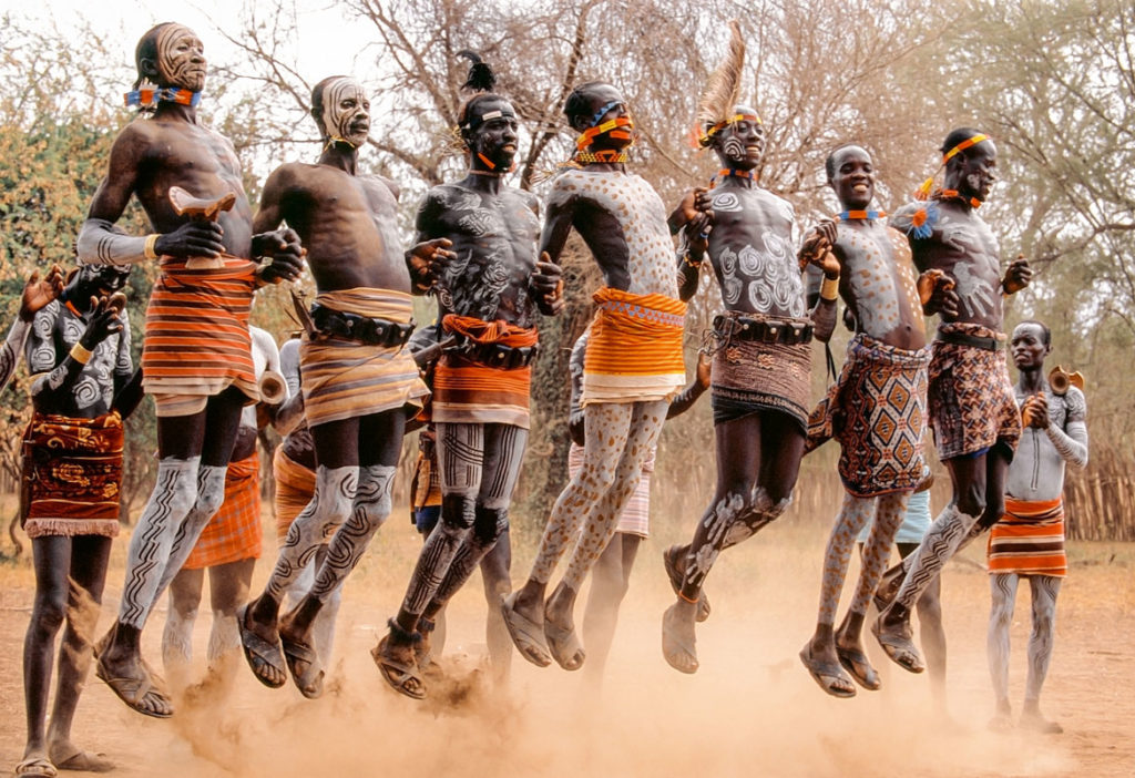 """Performing the courtship dance, young Kara men [of Ethiopia's Omo River valley] form long lines and leap high in the air to impress the admiring young women,"" Carol Beckwith and Angela Fisher write in ""African Twilight: The Vanishing Rituals and Ceremonies of the African Continent,"" 2018. (Rizzoli)"