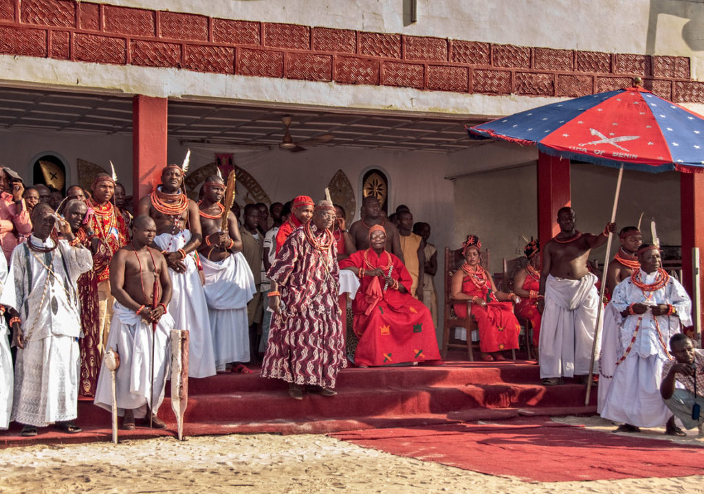 "In Nigeria, ""Seated on his throne, the Oba [or king] is surrounded by his three wives (right), the Ewaise chief (left), and royal courtiers (far left),"" Carol Beckwith and Angela Fisher write in ""African Twilight: The Vanishing Rituals and Ceremonies of the African Continent,"" 2018. (Rizzoli)"