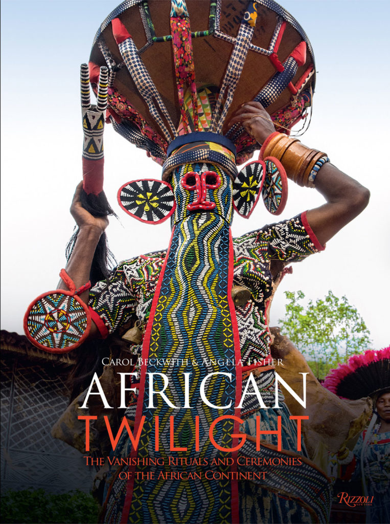 """The kuosi elephant mask is worn by members of the secret society of the Bamileke Fon of Bafoussam. With its elaborate beaded trunk, large elephant ears, and conical hat of ancestral figures, the mask symbolizes the wealth and power of the king."" It appears on the cover of ""African Twilight: The Vanishing Rituals and Ceremonies of the African Continent,"" volume 1, by Carol Beckwith and Angela Fisher, 2018. (Rizzoli)"