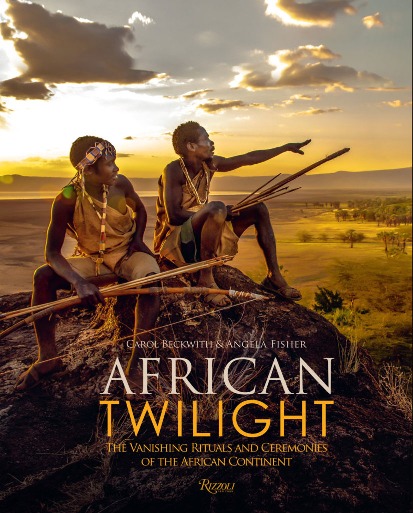 "Two Hadza hunters of Tanzania overlooking their territory bordering Lake Eyasi. Featured on the slipcase cover of ""African Twilight: The Vanishing Rituals and Ceremonies of the African Continent"" by Carol Beckwith and Angela Fisher, 2018. (Rizzoli)"