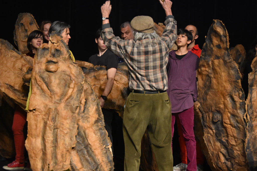 """Peter Schumann directs a rehearsal of Bread and Puppet Theater's """"Honey Let's Go Home! Opera"""" at Theater for the New City, New York, Dec. 6, 2019. (Greg Cook photo)"""