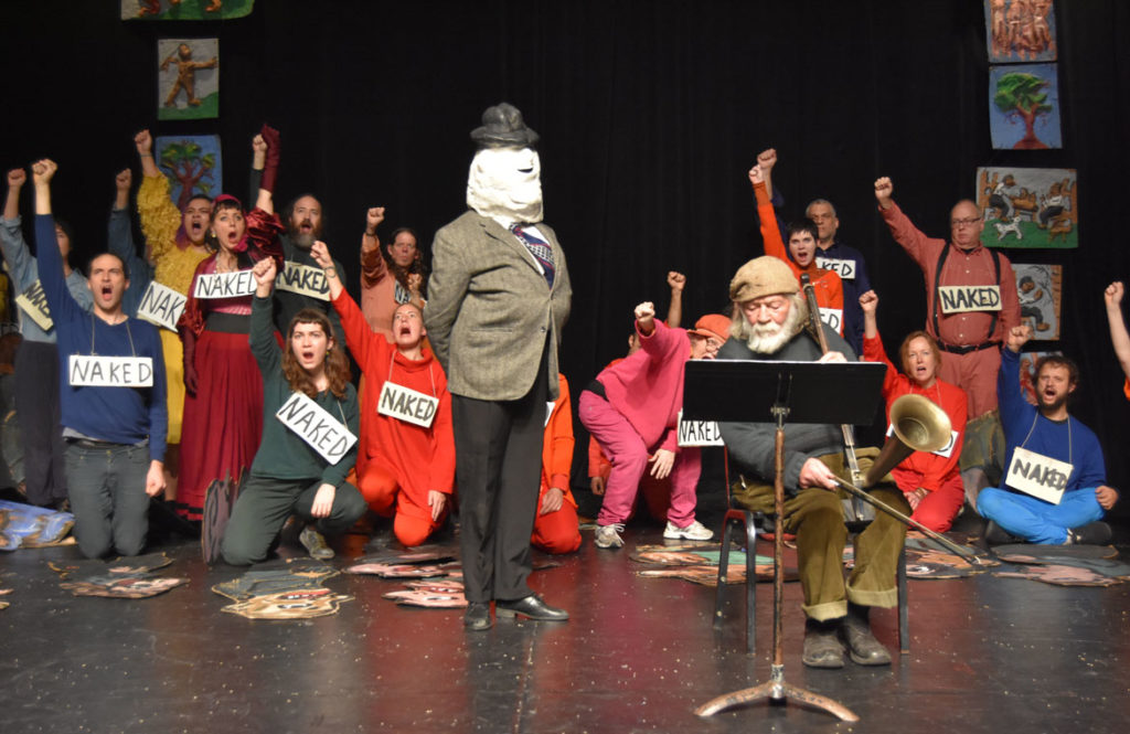 """Peter Schumann performs his fiddle sermon during Bread and Puppet Theater's """"Honey Let's Go Home! Opera"""" at Theater for the New City, New York, Dec. 6, 2019. (Greg Cook photo)"""