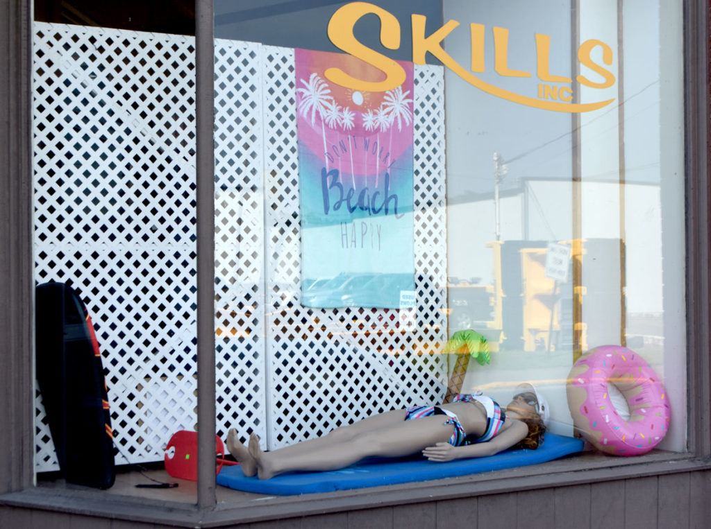 Skills store window, Skowhegan, Maine, July 30, 2019. (Greg Cook photo)