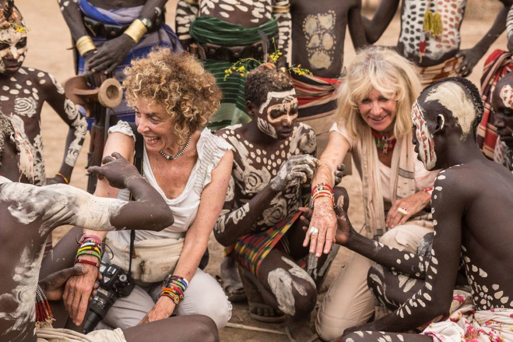 Carol Beckwith (left) and Angela Fisher painted by the Kara, Omo River, Ethiopia. (Rizzoli)