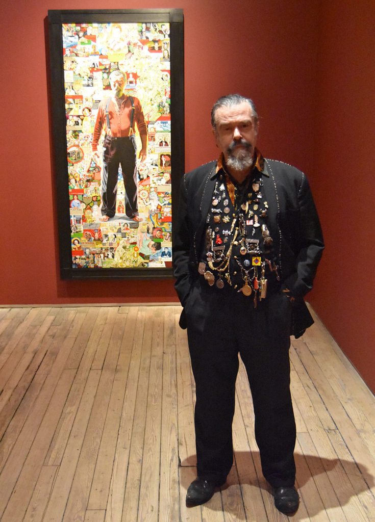 """Joe Coleman with his 2010 painting """"A Doorway to Joe"""" at Andrew Edlin Gallery, New York, Dec. 6, 2019. (Greg Cook photo)"""