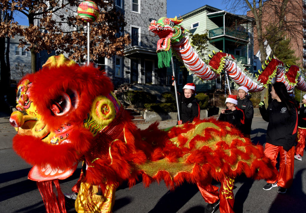 Wah Lum Kung Fu & Tai Chi Academy lion and dragon in Malden Parade of Holiday Traditions, Nov. 30, 2019. (Greg Cook photo)