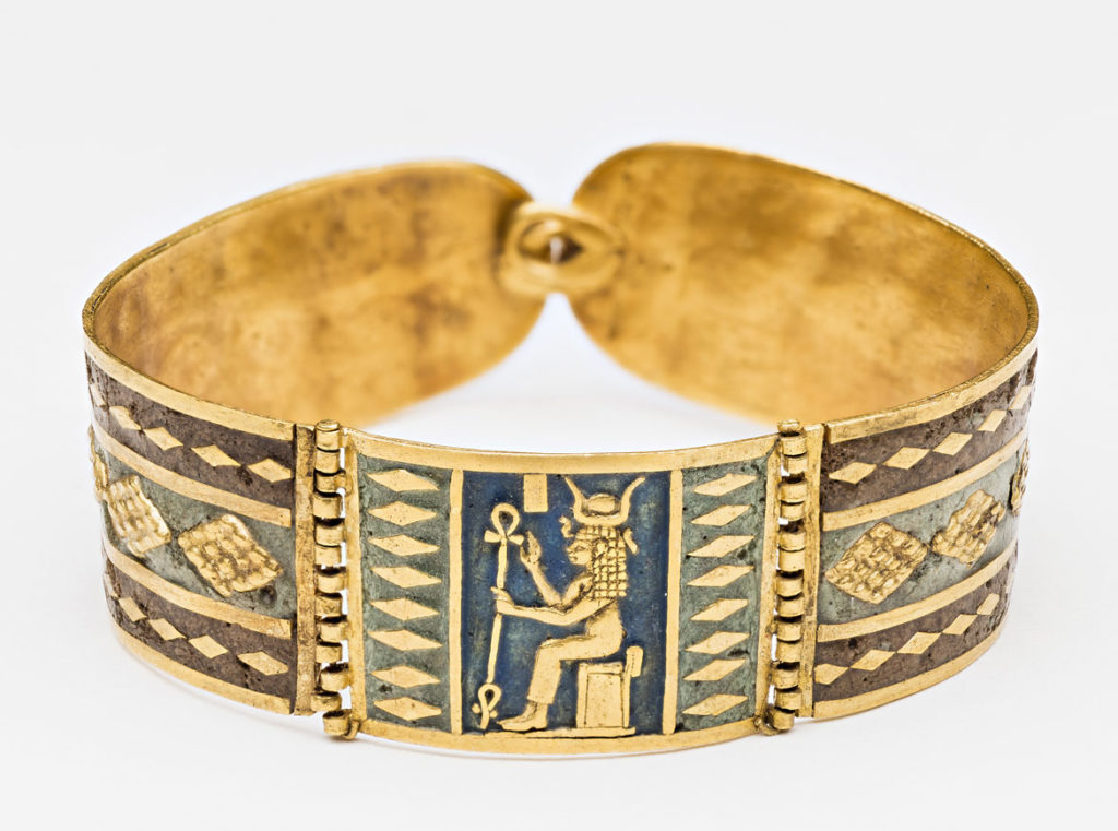 """Bracelet with image of Hathor, 250-100 BCE, Meroitic Period, gold, enamel. From """"Ancient Nubia Now"""" at Boston's Museum of Fine Arts."""