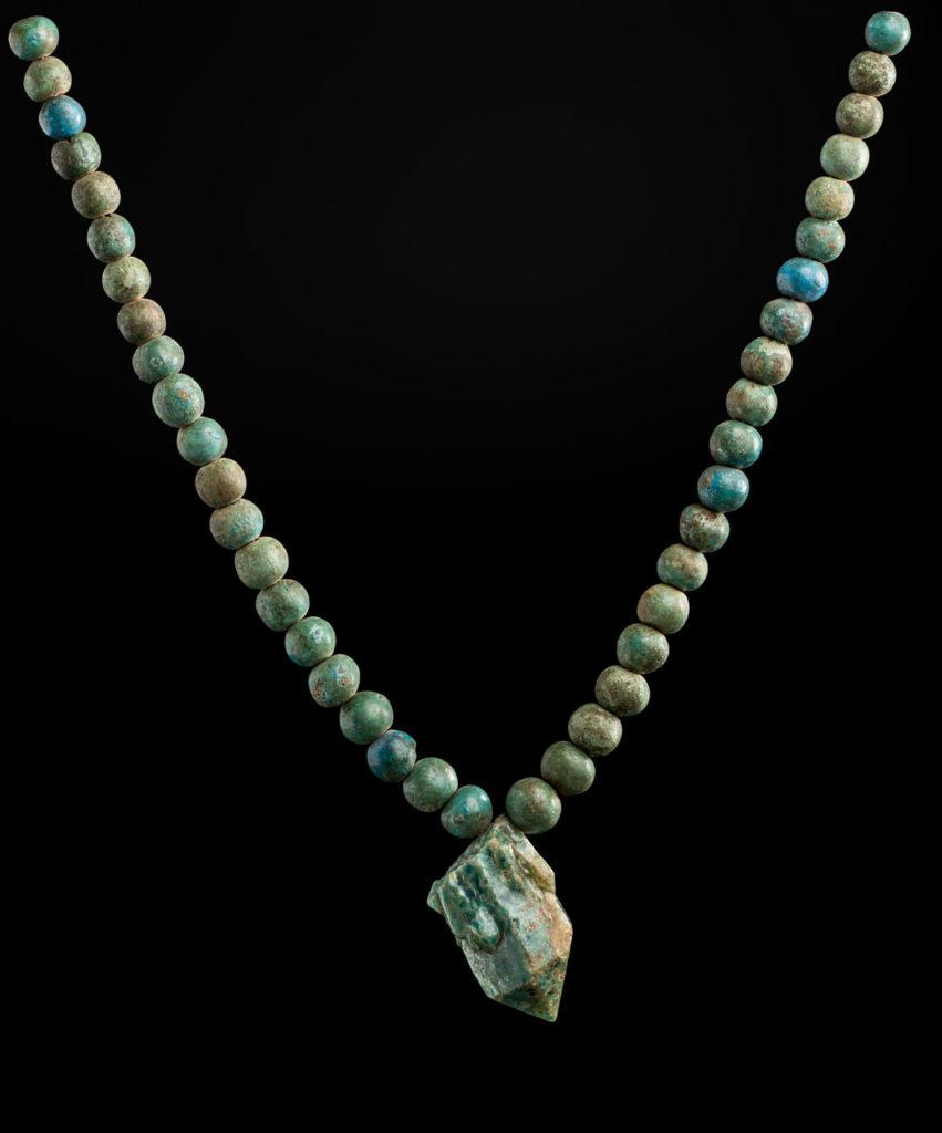 "Belt with a glazed quartz pendant, 1700-1550 BCE, Classic Kerma Period, faience, glazed quartz. From ""Ancient Nubia Now"" at Boston's Museum of Fine Arts."