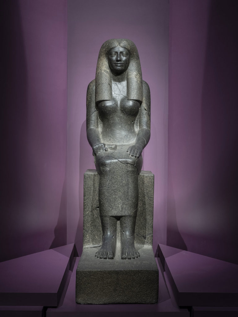 """Stone statue of Lady Sennuwy, Egyptian 1971-1926 BCE, found at Kerma. From """"Ancient Nubia Now"""" at Boston's Museum of Fine Arts."""