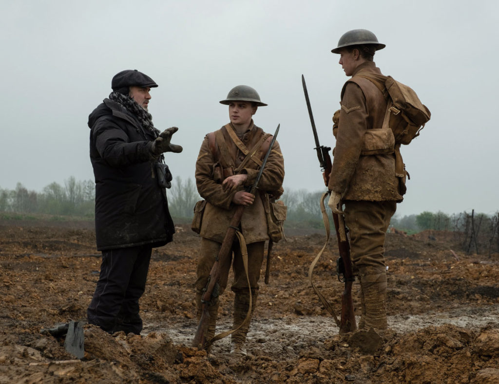 """Director Sam Mendes (from left), Dean-Charles Chapman and George MacKay on the set of """"1917."""" (François Duhamel / Universal Pictures and DreamWorks Pictures)"""