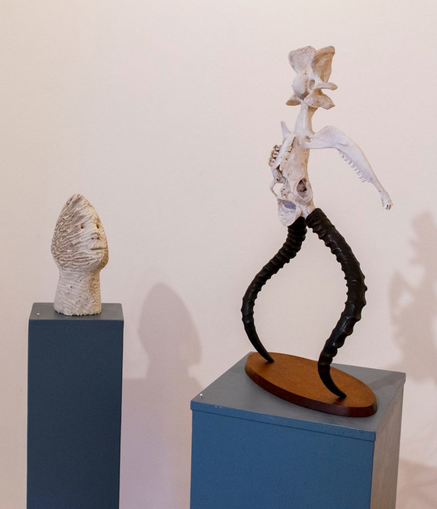 """Joseph Wheelwright, """"Beachcomber,"""" 2014, carved coral from the Bahamas (left), and """"Satyr,"""" 1987, found animal bones and impala horns purchased in New York City. (Gallery Kayafas, Boston)"""
