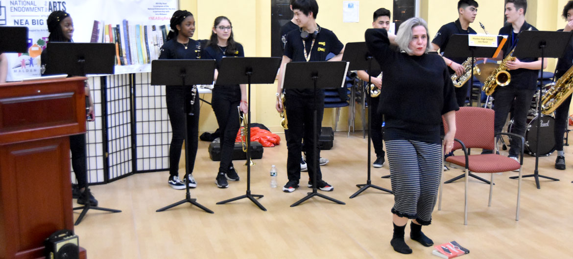 "Karen Krolak, artistic director of Monkeyhouse dance company, performs at the kickoff celebration for the 2020 ""Malden Reads,"" one-city, one-book reading program, at the Malden Senior Community Center on Saturday, Jan. 11, 2020. (Greg Cook photo)"