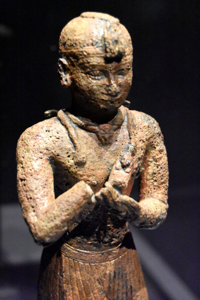 """Statuette of King Taharqua, Napatan period, reign of Taharqa, 690-662 BCE, found at Gebel Barkal, bronze. From """"Ancient Nubia Now"""" at Boston's Museum of Fine Arts, Jan. 15, 2020. (Greg Cook photo)"""