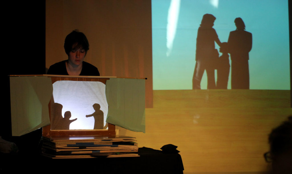 "Puppet Showplace Theatre's resident artist Sarah Nolen demonstrates a shadow sequence during a preview of ""My Night in the Planetarium"" in November 2019. (Tess Scheflan photo)"